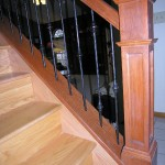 Stairway With Natural Cherry Railing With Iron Spindles